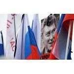 Плакаты и флаги участников траурного марша в Москве в память о политике Борисе Немцове Фото: РИА Новости