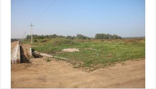 Техники нет, туалета нет – полигон ТКО за бердским кладбищем не строят