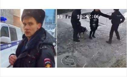 Участковый полиции и собачники в момент потасовки